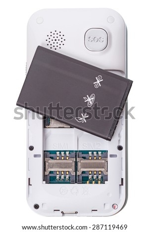 Cellular phone with dual SIM and battery  isolated on white background - stock photo