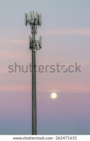 Cellular radio tower at dusk - stock photo