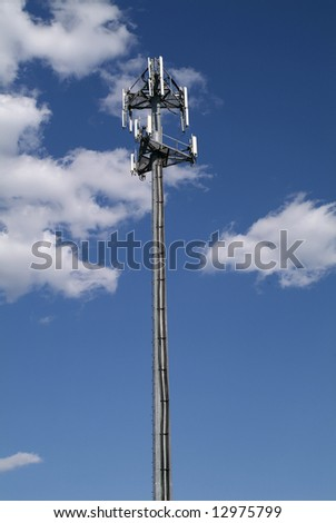 cellular repeater tower with blue sky and clouds