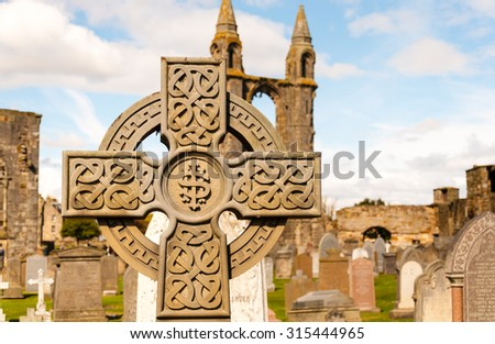 celtic cross on a graveyard at st. andrews, scotland - stock photo