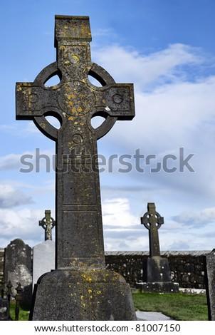 Celtic irish high cross -  walled graveyard of Rock of Cashel, Ireland - stock photo
