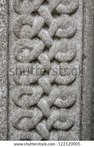 Celtic knot carved in stone in close up