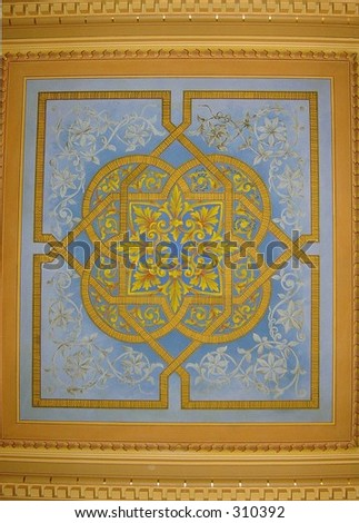 Celtic wedding knot painted on hand-carved wooden ceiling panel - stock photo