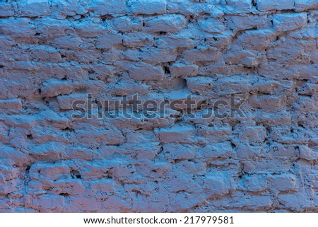 Cement brick wall with blue light - stock photo