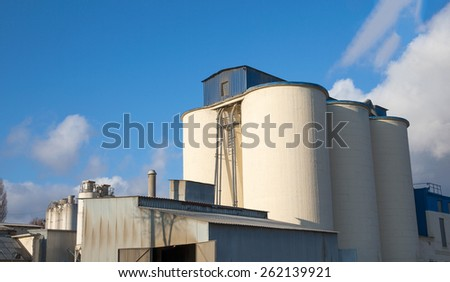 Cement factory silos and production buildings  - stock photo