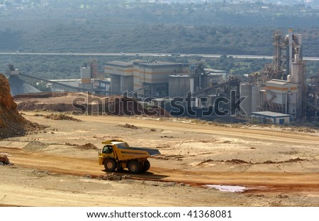 Cement factory with truck - stock photo