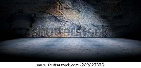 Cement floor and rock wall background and spotlight - stock photo