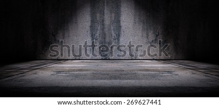Cement floor and wall background illuminated by spotlight - stock photo