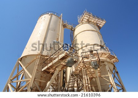 Cement industry plant with silos - stock photo