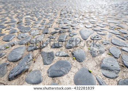 Cement mixed gravel stone floor texture background perspective view, focus on foreground - stock photo