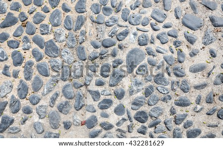 Cement mixed gravel stone floor texture background top view - stock photo
