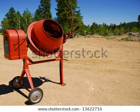 Cement mixer on a new construction site - stock photo