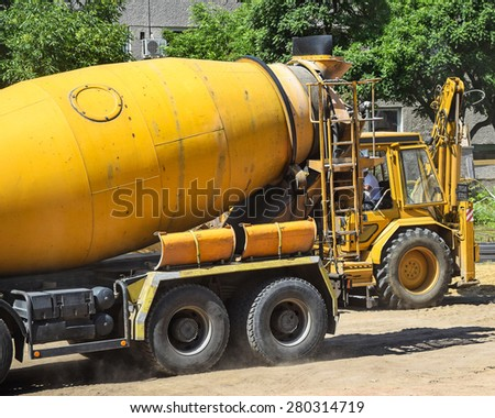 Cement mixer truck at the construction site - stock photo