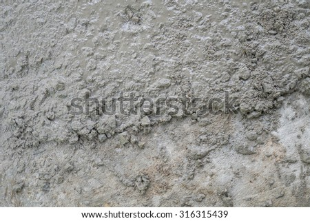 cement on newly paved road - stock photo