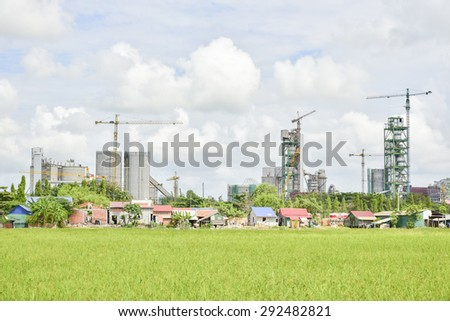 Cement plant in developing country,Concrete or cement factory, heavy industry or construction industry. - stock photo