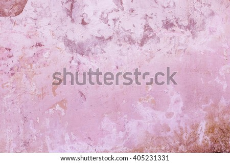 Cement red wall with traces of crumbling plaster and moss. textural composition - stock photo