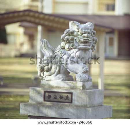 Cement Shi-Shi Dog, located outside of Tokyo, Japan. - stock photo