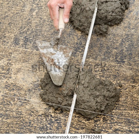 cement solution with a shovel
