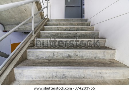 Cement stairs in building - stock photo