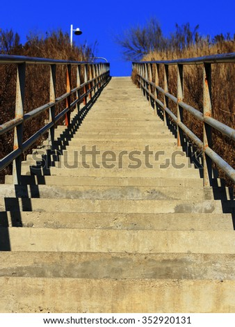 cement stairs leading up - stock photo