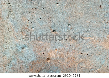 Cement Turquoise and Red Colored Wall. Scratched with holes. Grunge texture - stock photo