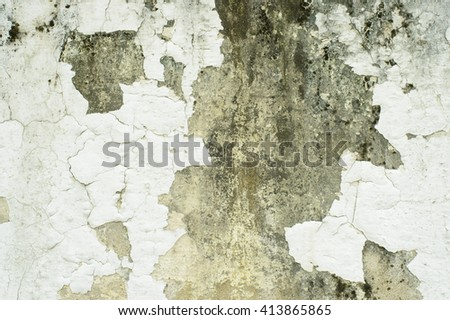 cement wall with white paint is severely weathered and peeling - stock photo