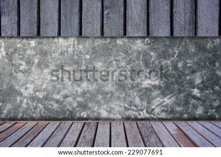 Cement wall with wooden shelves. - stock photo