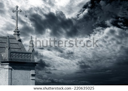 Cemetery chapel from an old european cemetery against cloudy sky - stock photo