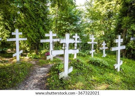 cemetery in campus of Wojnowo monastery, Warmian-Masurian Voivodeship, Poland - stock photo