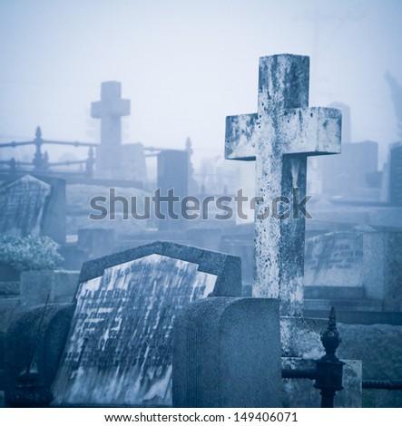 Cemetery in fog  - stock photo