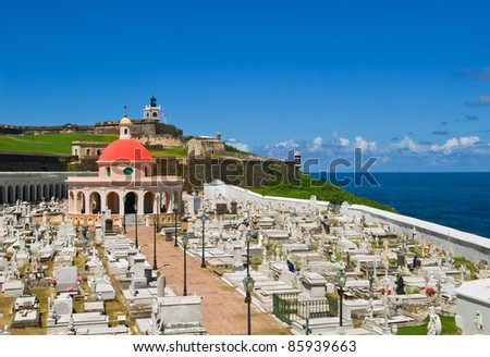 Cemetery in Old San Juan with chapel and fort - stock photo