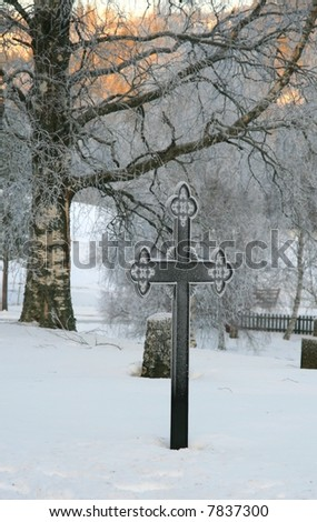 Cemetery in winter - stock photo