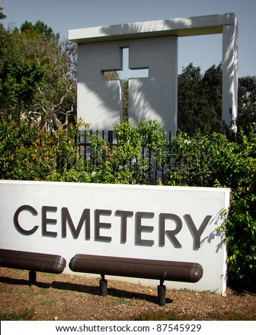 cemetery sign with cross in background - stock photo
