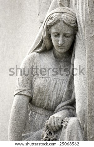 Cemetery statue of Mary Mourning closeup, copy space, Location Mount Olivet Cemetery in Nashville, TN - stock photo