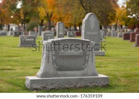 Cemetery Tombstone during fall season - stock photo