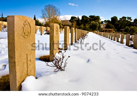 Cemetery under snow with clear sky - stock photo