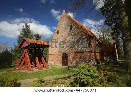 Cemetery with church and bell frame in Weitenhagen, Germany. - stock photo