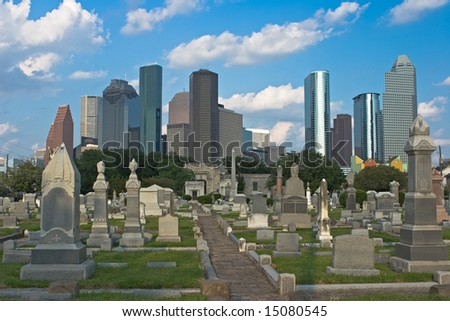 Cemetery with city skyline in the background - stock photo