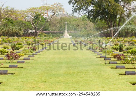 Cemetery with crosses in the cemetery And tombstones in the grass. - stock photo