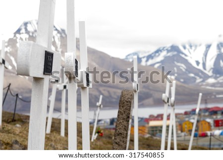 Cemetery with white wooden crosses in Longyearbyen, Svalbard, Norway - stock photo