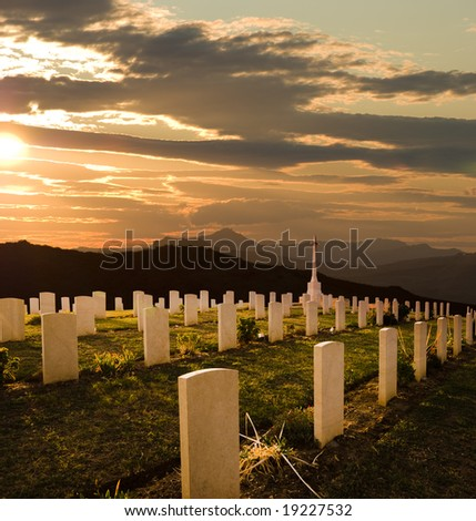 cemetery World War II at sunset - stock photo