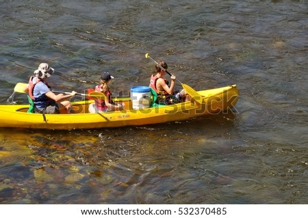 CENAC_ FRANCE,27 JULY, 2016: Tourists in canoe on the river Dordogne