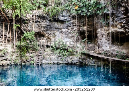 Cenote with transparent water in Mexico, Riviera Maya  - stock photo