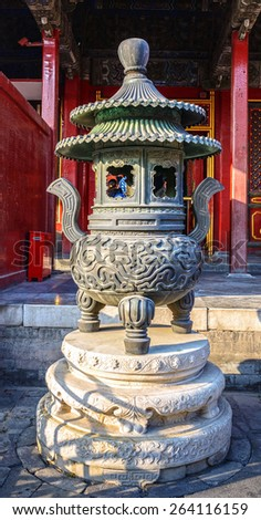 Censer of the Forbidden City. Made during Jiaqing period of the Qing dynasty. Located in The Palace Museum (Forbidden City), Beijing, China. - stock photo