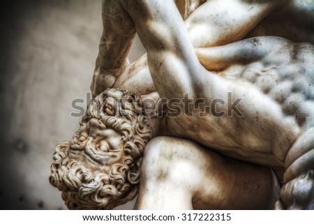 Centaur head  close up of Hercules and Nesso centaur statue in Loggia dei Lanzi in Florence, Italy - stock photo