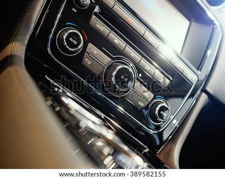 Center console of a luxury car, shallow depth of field - stock photo
