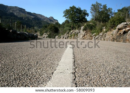 Center line of a country road in the Tramuntana mountains at the island Majorca, Spain - stock photo