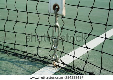 Center net strap of tennis hard court - stock photo