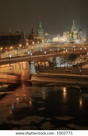 Center of moscow with kremlin and illuminated orthodox church - stock photo