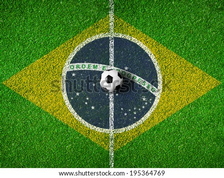 Center of soccer or football pitch with flag of Brazil - stock photo